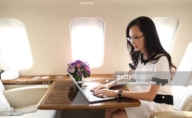 Jenny Lau President and CEO of Sion Jet poses for picture in a jet at Hong Kong International Airport in Chek Lap Kok 19SEP14