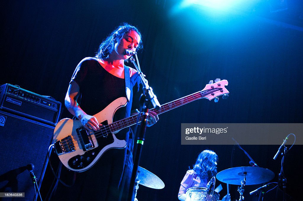 Jenny Lee Lindberg and Stella Mozgawa of Warpaint performs on stage at Music Hall of Williamsburg on October 1, 2013 in New York, New York.