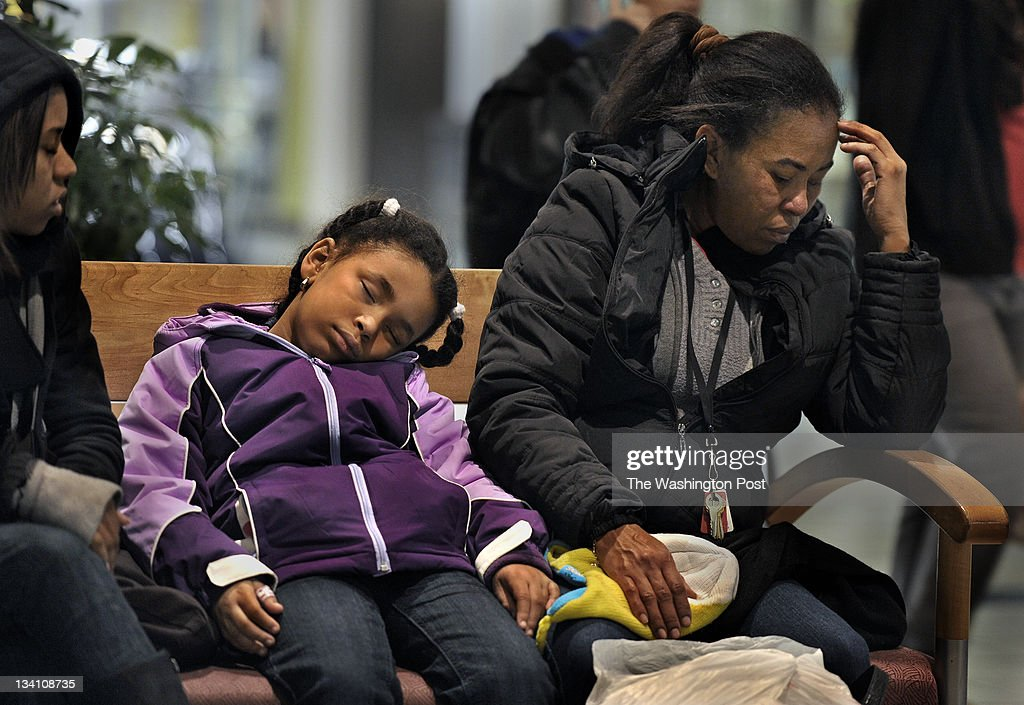 Jenny Leonardo (age 19), her little sister Diana Leonardo (age 5) and mom Jeanet Leonardo were all very tired at 5:30 a.m. as they had been at the mall since last night at 7:00 p.m. (the first stores didn't open until midnight) They were waiting for a bus that wasn't scheduled to come until about 6:00 a.m. Black Friday began at midnight at The Mall at Prince Georges in Hyattsville Maryland.