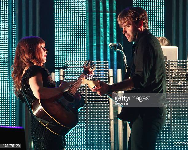 Jenny Lewis and Ben Gibbard of The Postal Service perform during Lollapalooza 2013 at Grant Park on August 3 2013 in Chicago Illinois