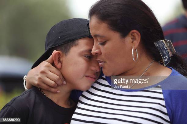 Jenny Martinez hugs her son William Martinez as they talk to the media about her trip from El Salvador and her need for asylum in America because of...