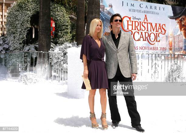 Jenny McCarthy and actor Jim Carrey attend Walt Disney's 'A Christmas Carol' Photo Call and Press Conference at the Carlton Hotel during the 62nd...
