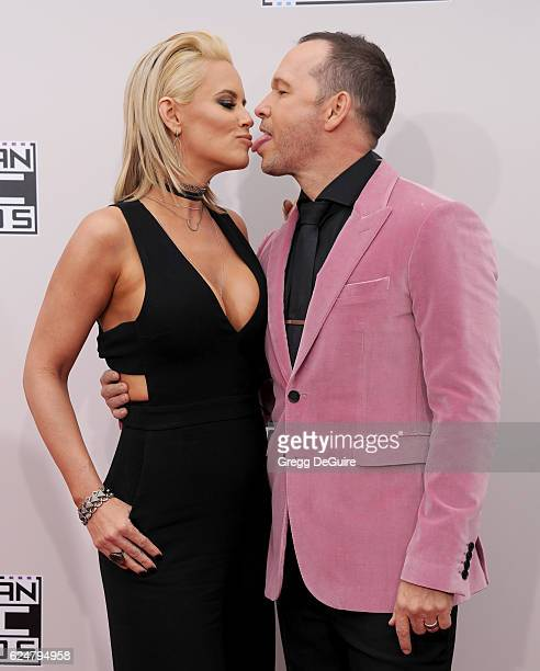 Jenny McCarthy and Donnie Wahlberg arrive at the 2016 American Music Awards at Microsoft Theater on November 20 2016 in Los Angeles California