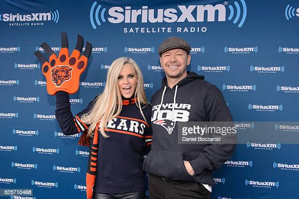 Jenny McCarthy and Donnie Wahlberg attend during Jenny McCarthy's SiriusXM show from Grant Park in Chicago IL before the NFL Draft on April 28 2016...