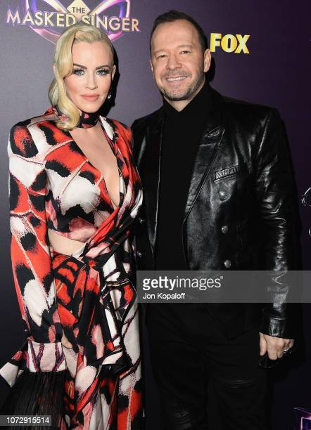 Jenny McCarthy and Donnie Wahlberg attend Fox's The Masked Singer Premiere Karaoke Event at The Peppermint Club on December 13 2018 in Los Angeles...