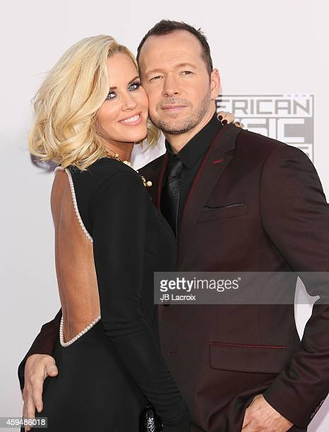 Jenny McCarthy and Donnie Wahlberg attend the 2014 American Music Awards at Nokia Theatre LA Live on November 23 2014 in Los Angeles California