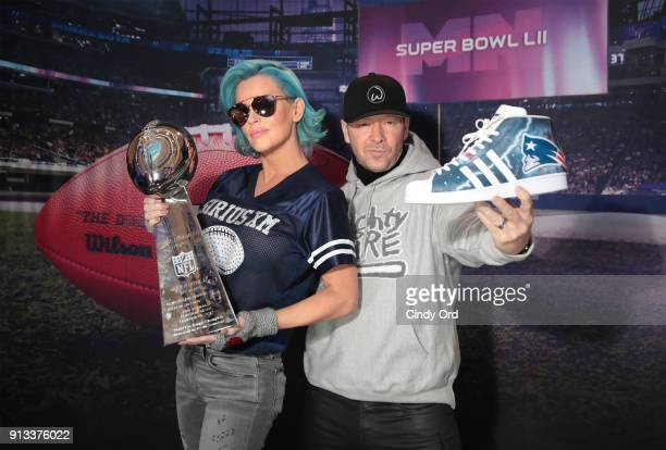 Jenny McCarthy and Donnie Wahlberg visit the SiriusXM at Super Bowl LII Radio Row at the Mall of America on February 2 2018 in Bloomington Minnesota
