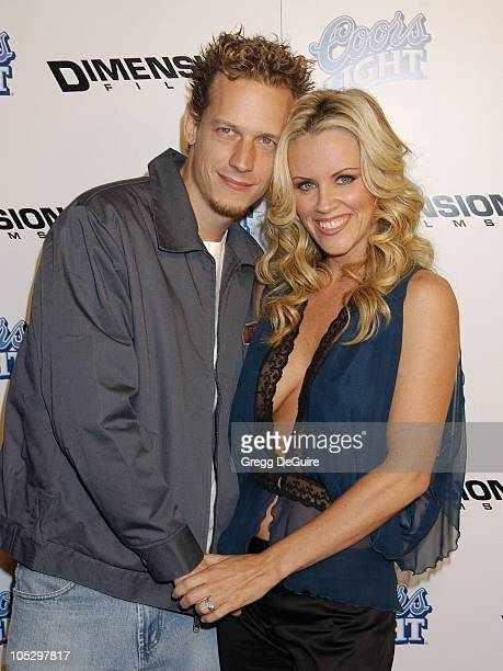 """Jenny McCarthy and husband John Asher during """"Scary Movie 3"""" Premiere - Arrivals at AMC Theatres Avco Cinema in Westwood, California, United States."""