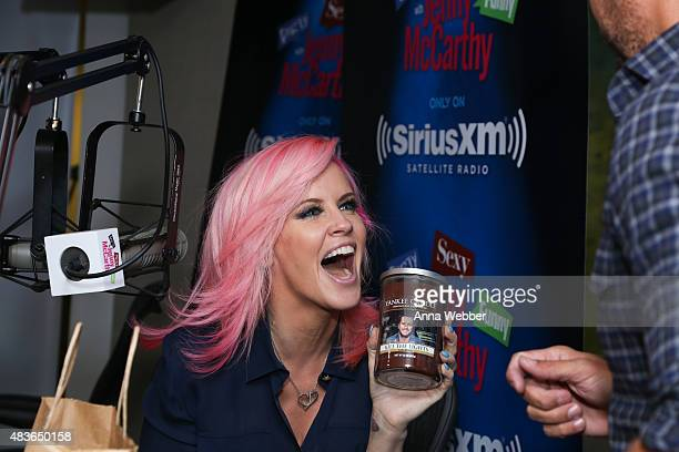 Jenny McCarthy interviews Luke Bryan on the set of 'Dirty, Sexy, Funny with Jenny McCarthy' at the SiriusXM on August 11, 2015 in New York City.