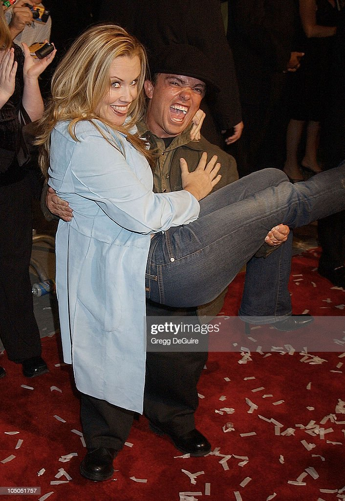 Jenny McCarthy & Jason 'Wee Man' Acuna during 'Jackass: The Movie' Premiere at Cinerama Dome in Hollywood, California, United States.