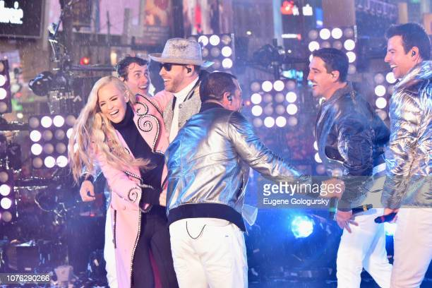Jenny McCarthy Joey McIntyre Donnie Wahlberg Danny Wood Jonathan Knight and Jordan Knight on stage during Dick Clark's New Year's Rockin' Eve With...
