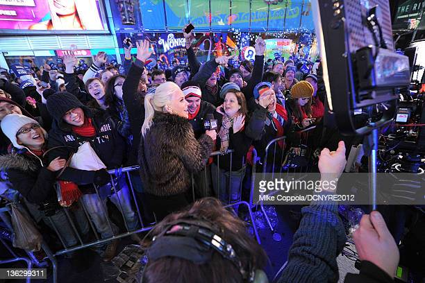 Jenny McCarthy poses with fans during Dick Clark's New Year's Rockin' Eve with Ryan Seacrest 2012 at Times Square on December 31, 2011 in New York...