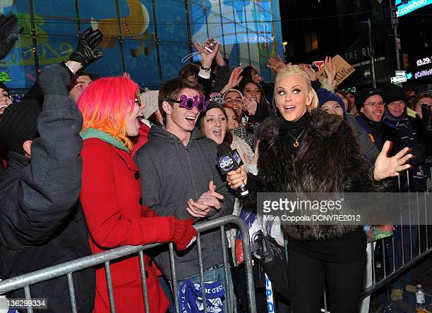 Jenny McCarthy poses with fans during Dick Clark's New Year's Rockin' Eve with Ryan Seacrest 2012 at Times Square on December 31 2011 in New York City