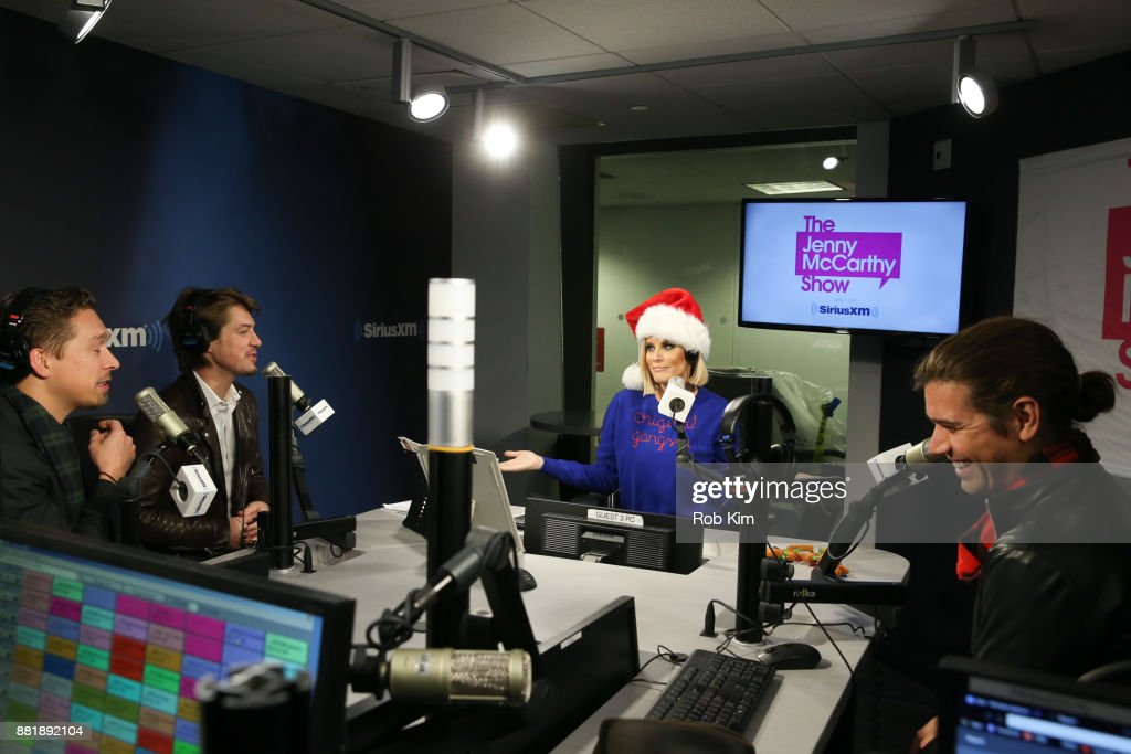 Jenny McCarthy talks with members of Hanson, L-R Isaac Hanson, Taylor Hanson and Zac Hanson on ''The Jenny McCarthy Show' at SiriusXM Studios on November 29, 2017 in New York City.