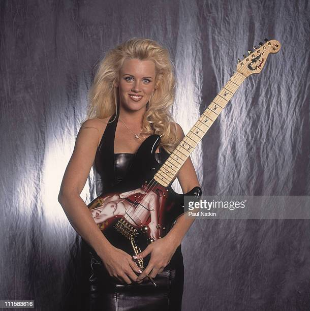 Jenny McCarthy with a Fender/Playboy Marilyn Monroe Guitar on 4/15/93 in Chicago Il