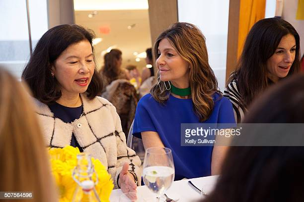 Jenny Ming and Lisa Perry socialize at Barneys New York on January 29 2016 in San Francisco California
