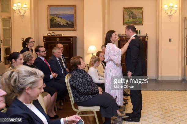 Jenny Morrison wife of Australian Prime Minister Scott Morrison congratulates Australian Treasurer Josh Frydenberg after being sworn in by...