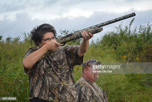 Jenny Moss aims at a dove flying across a field on the Poosey Conservation Area as her husband Mark looks on during a special hunt for firsttime...