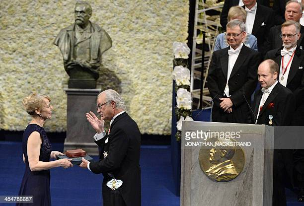 Jenny Munro daughter of Alice Munro the 2013 Nobel Prize for Literature receives a medal on behalf of her mother from King of Sweden Carl XVI Gustaf...