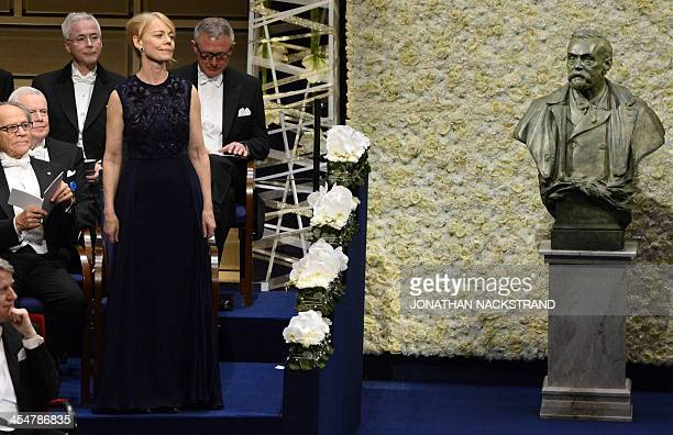 Jenny Munro daughter of Alice Munro the 2013 Nobel Prize for Literature waits to receive a medal on behalf of her mother from King of Sweden Carl XVI...