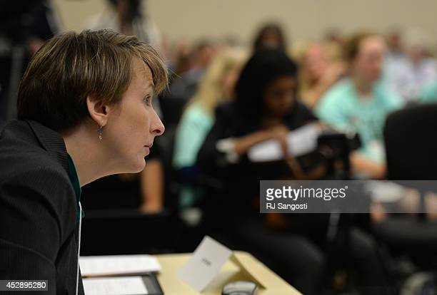 Jenny Noonan, of the EPA, listens public hearings, on proposed carbon pollution plan and proposed carbon pollution standards for modified...