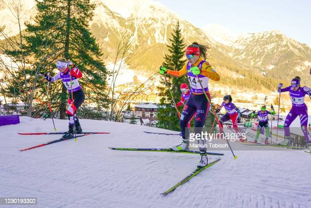 Jenny Nowak of Germany and Claudia Purker of Austria competes during the Women's Gundersen Normal Hill HS98/5.0 Km at the FIS Nordic Combined World...