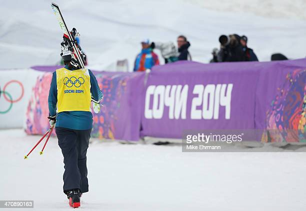 Jenny Owens of Australia walks away from the finish area in the Freestyle Skiing Womens' Ski Cross 1/8 Finals on day 14 of the 2014 Winter Olympics...