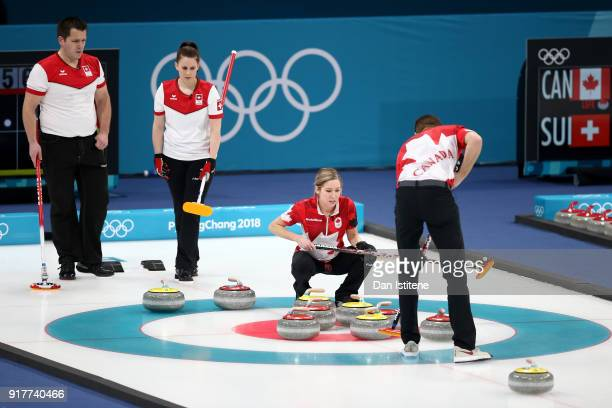 Jenny Perret and Martin Rios of Switzerland compete against Kaitlyn Lawes and John Morris of Canada during the Curling Mixed Doubles Gold Medal Game...