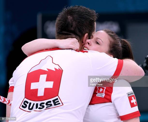 Jenny Perret of Switzerland celebrates a 75 victory over Olympic Athletes from Russia team with Martin Rios to advance to the gold medal match...