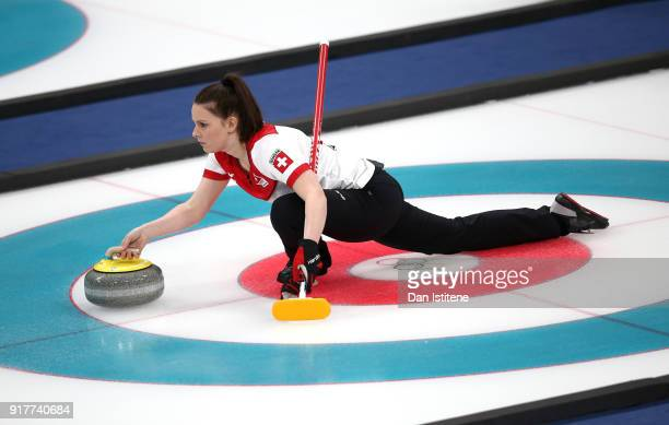 Jenny Perret of Switzerland delivers a stone against Canada during the Curling Mixed Doubles Gold Medal Game on day four of the PyeongChang 2018...