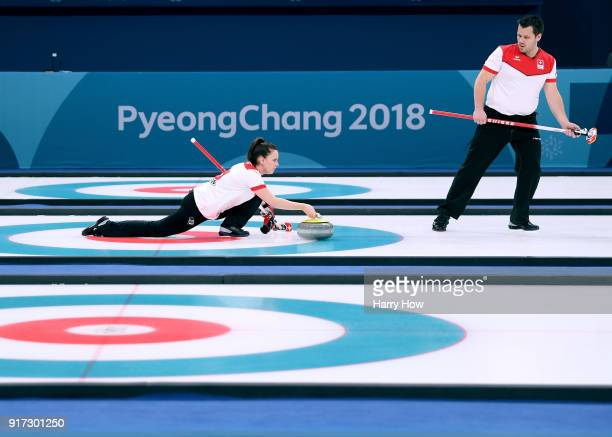 Jenny Perret of Switzerland throws a rock as Martin Rios waits to sweep in a 75 victory over the Olympic Athletes from Russia team to advance to the...