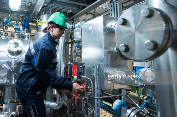 Jenny Pietzsch engineer of biotechnology at the demo plant of the french biotech company Global Bioenergies checks a reactor during the inauguration...