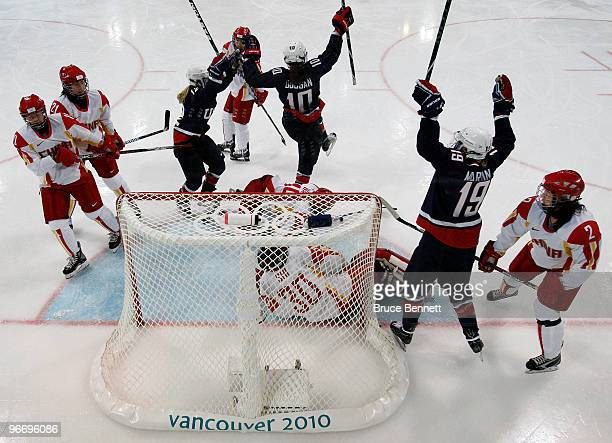 Jenny Porter Meghan Duggan and Gigi Marvin of the United States celebrate after a goal against China during their women's ice hockey preliminary game...