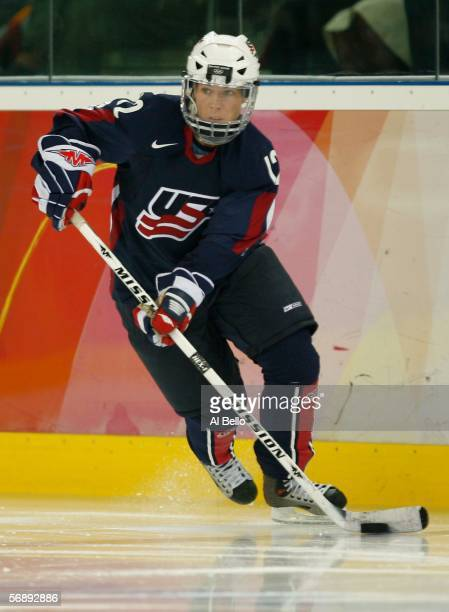Jenny Potter of the United States controls the puck during the women's ice hockey bronze medal match against Finland during Day 10 of the Turin 2006...