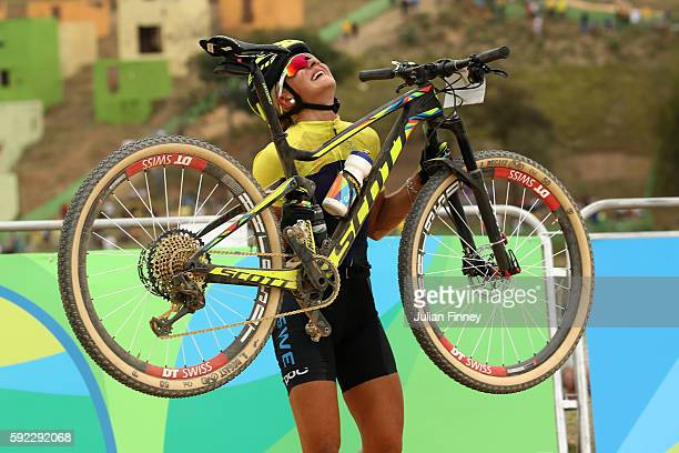 Jenny Rissveds of Sweden celebrates after finishing first during the Women's CrossCountry Mountain Bike Race on Day 15 of the Rio 2016 Olympic Games...
