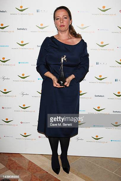 Jenny Saville poses with her award at the Women for Women International Gala dinner in association with Harper's Bazaar at The Guildhall on May 3...
