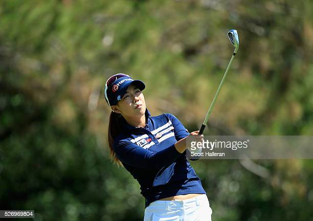 Jenny Shin hits her tee shot on the 13th hole during the final round of the Volunteers of America Texas Shootout at Las Colinas Country Club on May 1...
