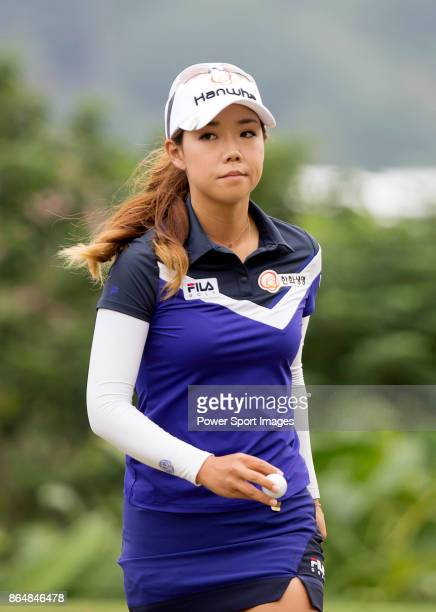 Jenny Shin of South Korea holds the ball after sinking a putt on the third hole during day four of Swinging Skirts LPGA Taiwan Championship on...