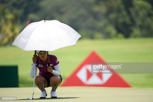 Jenny Shin of South Korea lines up a putt on the 16th green during the final round of the HSBC Women's World Championship at Sentosa Golf Club on...