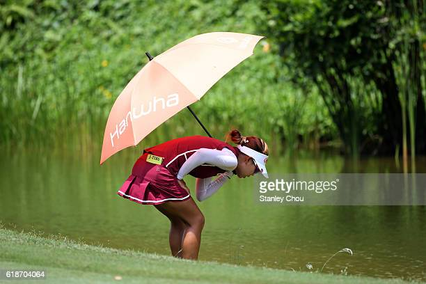 Jenny Shin of South Korea looks for her golf ball on the 13th hole during day two of the Sime Darby LPGA at TPC Kuala Lumpur on October 28 2016 in...