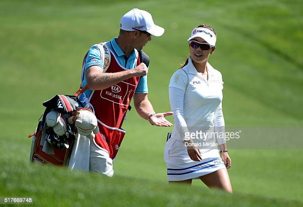 Jenny Shin walks and talks with caddie on the 1st fairway during Round Three of the KIA Classic at the Park Hyatt Aviara Resort on March 26 2016 in...