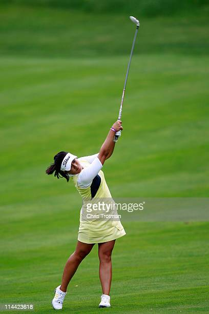 Jenny Suh hits her second shot to the tenth green during round one of the Sybase Match Play Championship at Hamilton Farm Golf Club on May 19 2011 in...