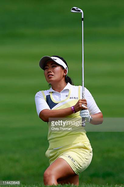 Jenny Suh hits out of a bunker on the ninth green during round one of the Sybase Match Play Championship at Hamilton Farm Golf Club on May 19 2011 in...