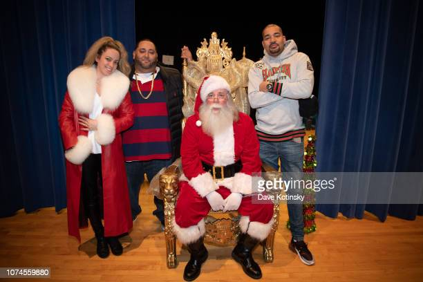 Jenny Tips Cesar and DJ Envy arrive at Cesar DJ Envy's 2018 Holiday Toy Giveaway on December 21 2018 in Paterson New Jersey