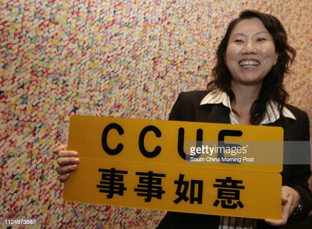 Jenny Tsui show her newly buy vehicle registration marks C C U E to the press during the Auction of Personalized vehicle at HKCEE on 16 September...
