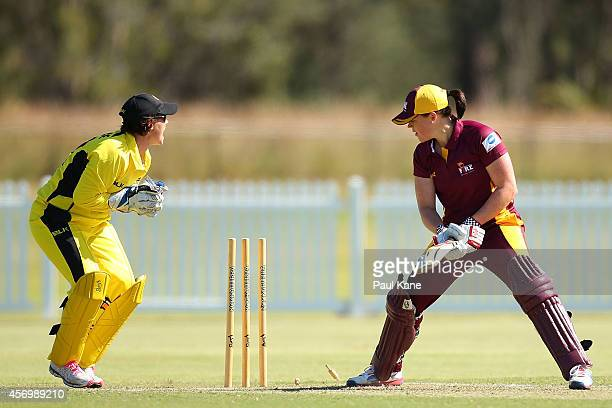 Jenny Wallace of Western Australia appeals unsuccessfully for the stumping of Grace Harris of Queensland during the WT20 match between Western...
