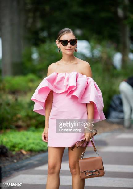 Jenny Walton is seen wearing pink off shoulder dress outside Carolina Herrera during New York Fashion Week September 2019 on September 09 2019 in New...