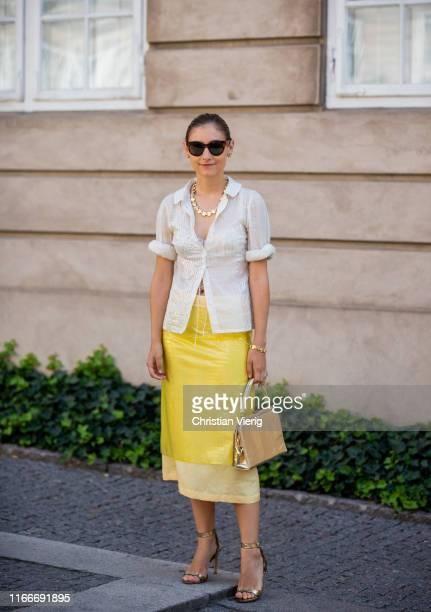 Jenny Walton is seen wearing yellow skirt outside Helmstedt during Copenhagen Fashion Week Spring/Summer 2020 on August 07, 2019 in Copenhagen,...