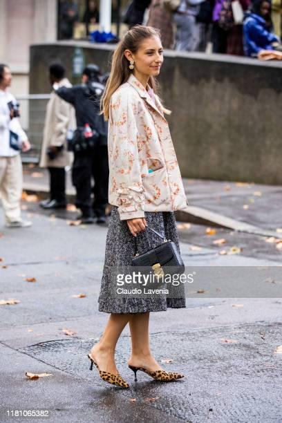 Jenny Walton, wearing a floral print jacket, grey midi skirt and leopard print mules, is seen outside the Miu Miu show during Paris Fashion Week -...