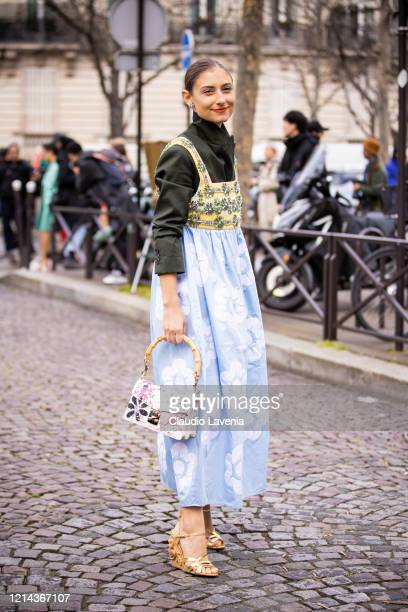 Jenny Walton, wearing a olive green shirt, light blue decorated maxi dress, printed Miu Miu bag and gold sandals, is seen outside Miu Miu, during...